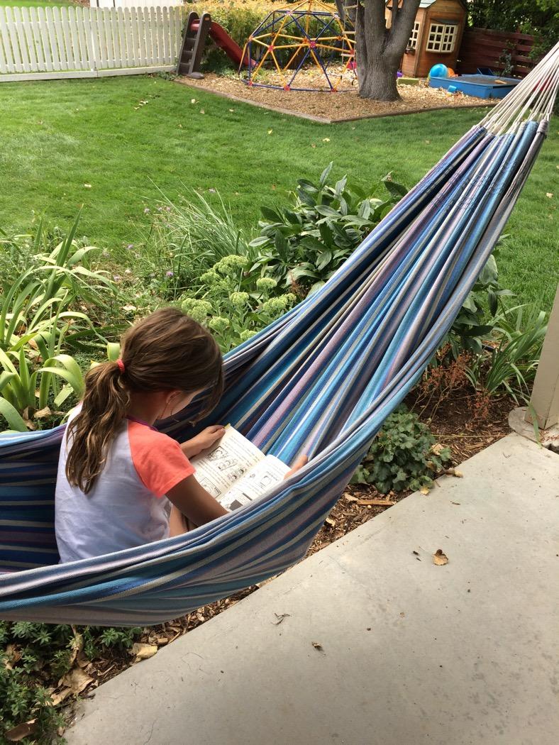 Afthead reading in a hammock